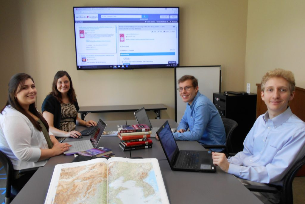 Social sciences librarian Diana Symons instructs USPP research assistants Meghan Keaveny (front left), Jacob Wankel, and Jim Hasselbrink in database research methods for a follow-up study of Kim Jong-un's personal psychology as a basis for conducting an updated North Korea threat assessment, Aug. 4, 2017.