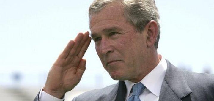 George W. Bush salutes.