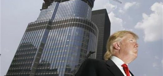 In this May 24, 2007, file photo, Donald Trump is profiled against his 92-story Trump International Hotel & Tower during a news conference on construction progress in Chicago.
