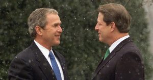 Vice President Al Gore (R) shakes hands with President-elect George W. Bush after Bush arrived for a meeting December 19, 2000.