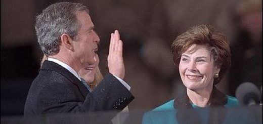 Photo of George W. Bush being sworn in as the 43rd President in an inaugural ceremony at the United States Capitol.