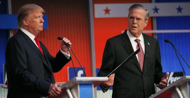 Republican 2016 presidential candidates, businessman Donald Trump (L) and former Florida Governor Jeb Bush, take their places at their podiums before the start of the first official Republican presidential candidates debate of the 2016 U.S. presidential campaign in Cleveland, Ohio, August 6, 2015.