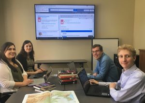 Social sciences librarian Diana Symons instructs USPP summer research fellows Meghan Keaveny (front left), Jacob Wankel, and Jim Hasselbrink on bibliographic database searching for a North Korea threat assessment research project, Aug. 4, 2017.